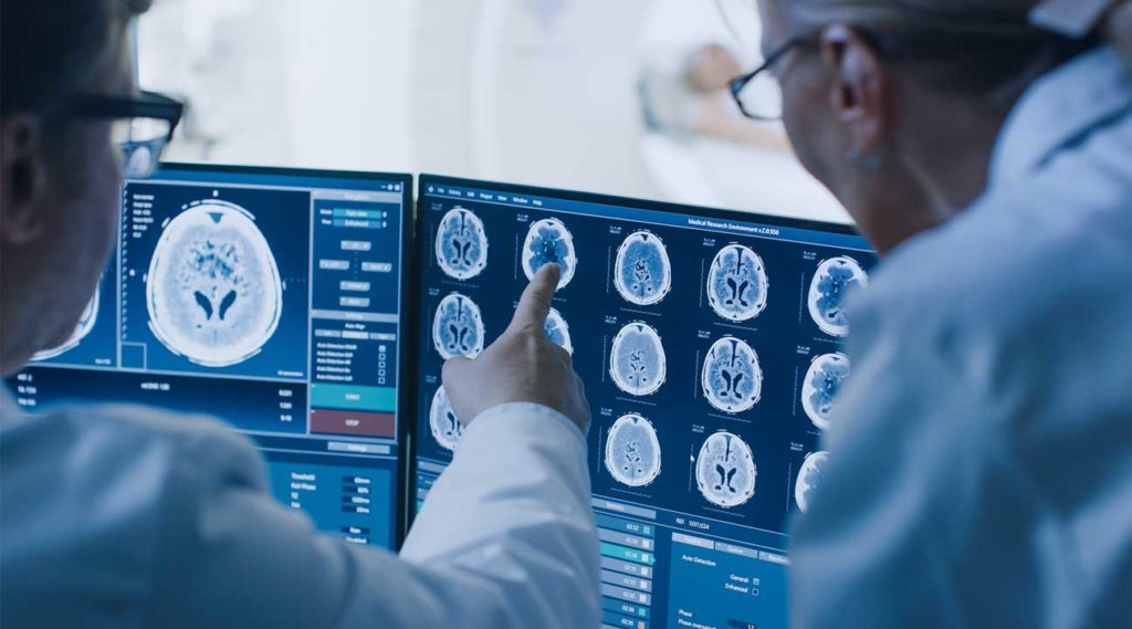 doctors and researchers examining brain scan of patients struggling with drug and alcohol addiction