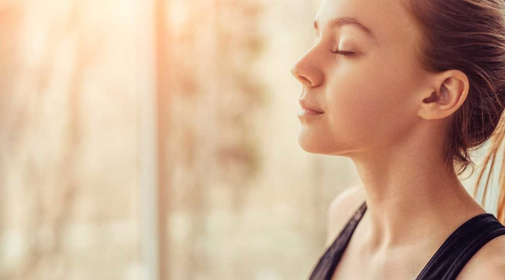 young woman practicing yoga mindfulness concentration