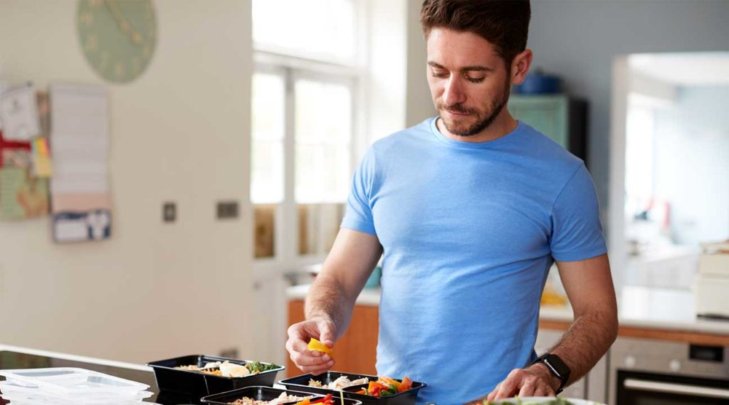 man prepping nutritional meals