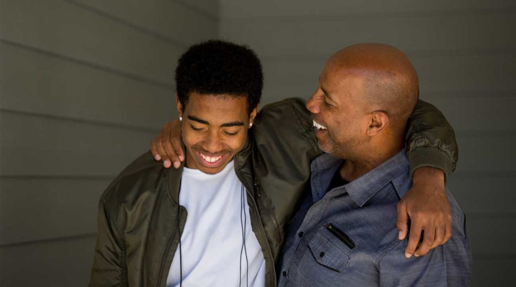 father talking to his son about the dangers of drugs and alcohol