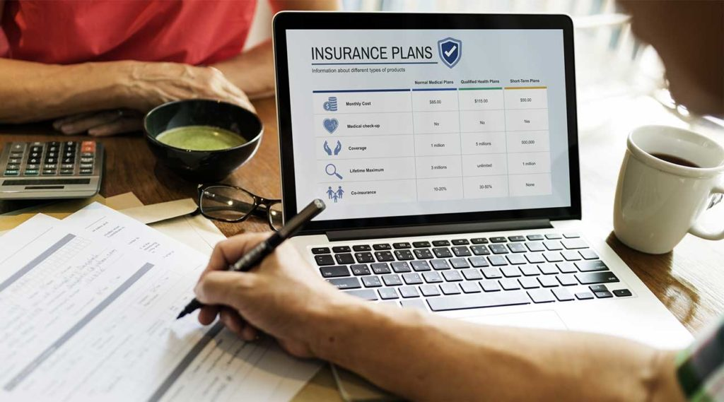 couple looking at their health insurance options Coventry Health care